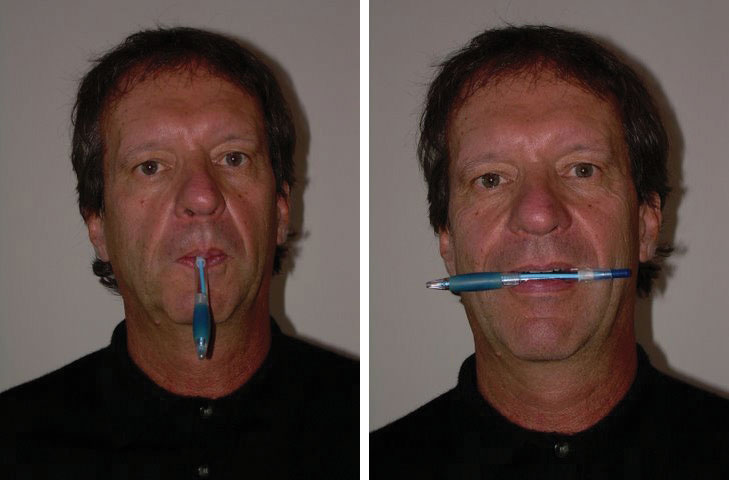 The author of this book holding a pen in his mouth from the back end, and a different picture with the pen horizontal