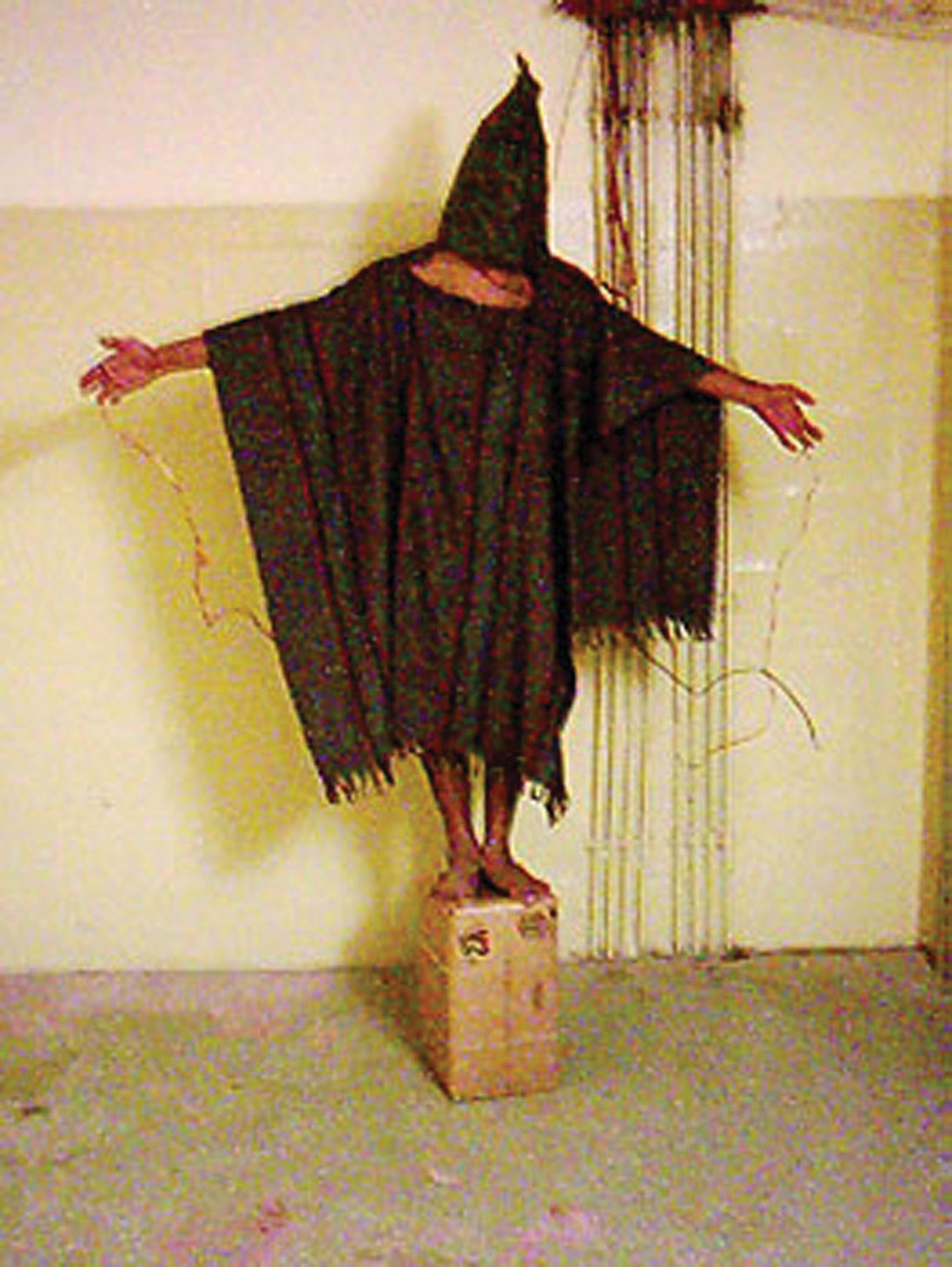 Photo of an Iraqi prisoner being tortured by soldiers at the Abu Gharib prison