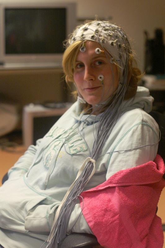 A woman wearing an EEG cap