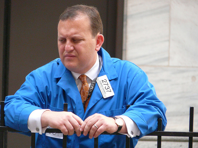 A stock trader looking sad