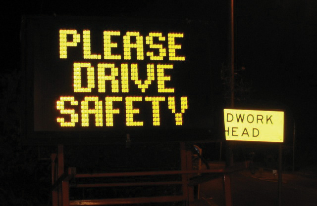 A lit up road sign saying