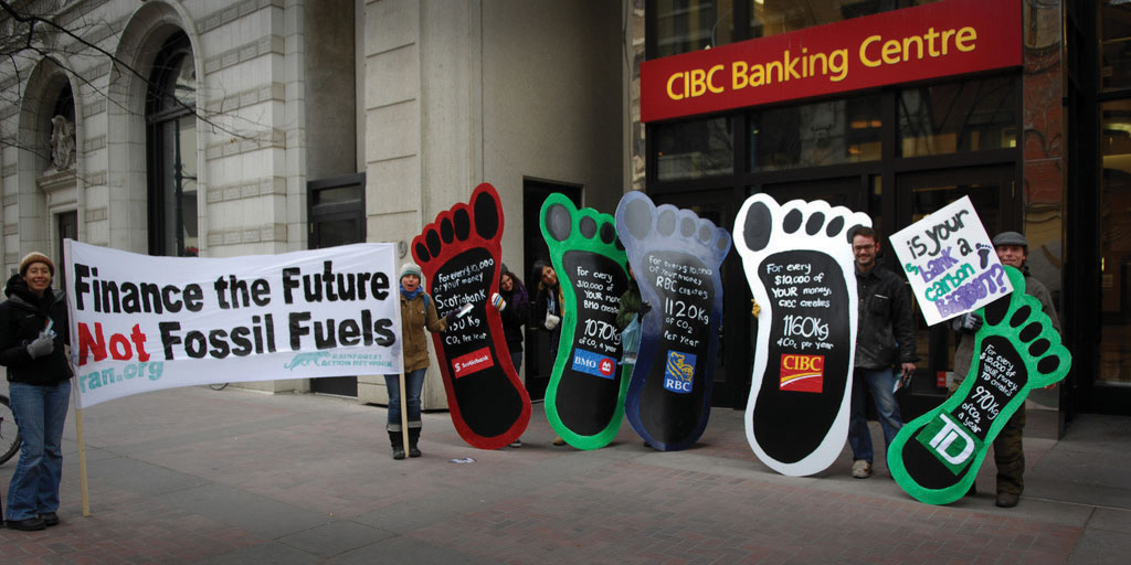 Protesters ralling against climate change in front of CIBC Banking Centre