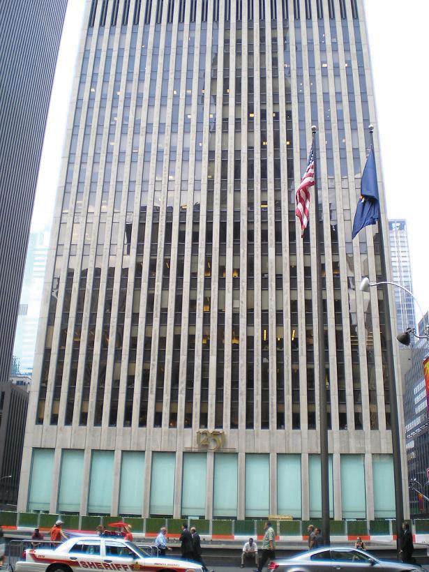 A skyscraper housing the company of Exxon