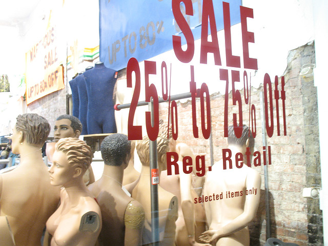 A sale window showing a very steep sale on clothing
