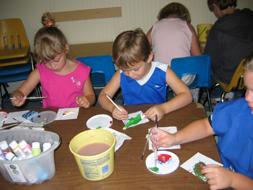 Children painting and making crafts
