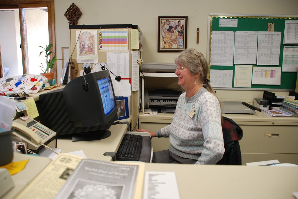 A woman at a desk, an employee of clerical work