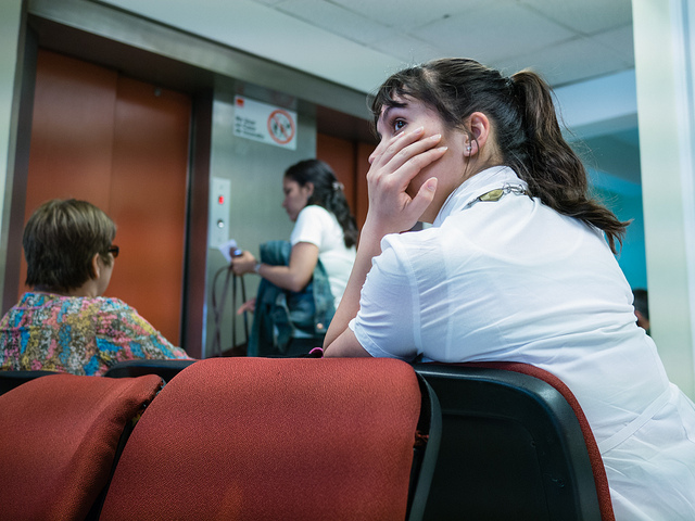 A woman waiting for a doctor in the hospital waiting room