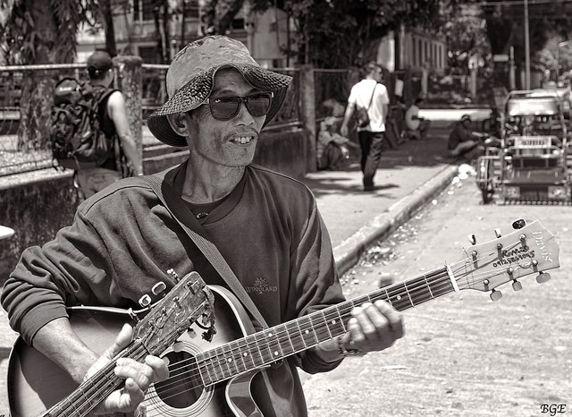 A street Musician holding his guitar
