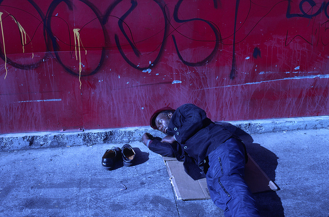 A homeless man sleeping on the streets of Los Angeles