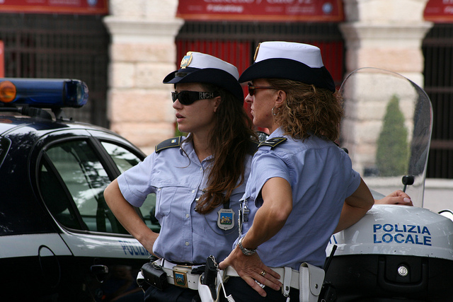 Two women police officers standing next to each other