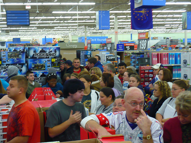 A picture of the chaos of Walmart on Black Friday. Customers everywhere in disordered lines, waiting to check out