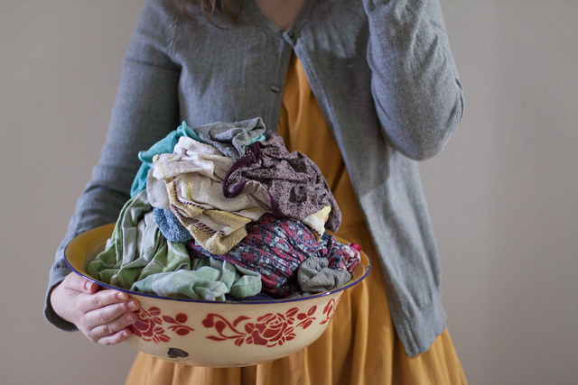 A woman with a bowl full of laundry