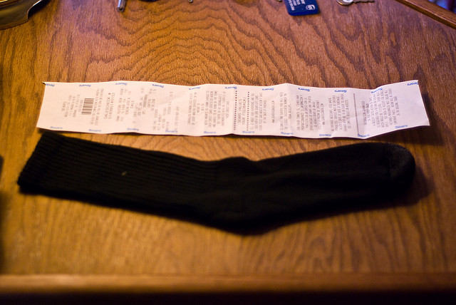 A very long repair bill being compared to a high sock!
