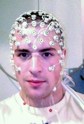 A man wearing an EEG cap