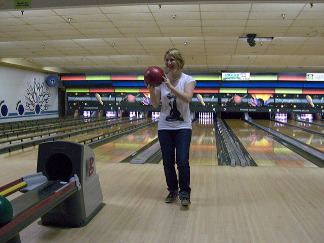 A woman bowling