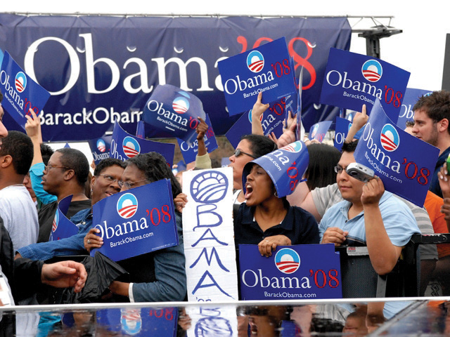 A crowd cheering for Barack Obama
