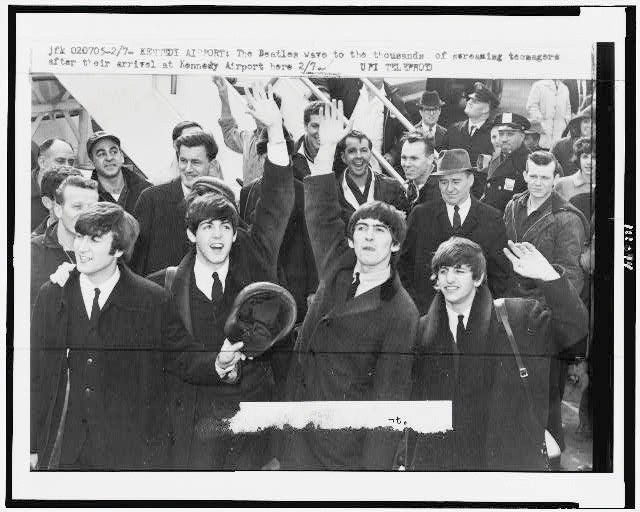 An old newspaper article featuring a picture of The Beatles