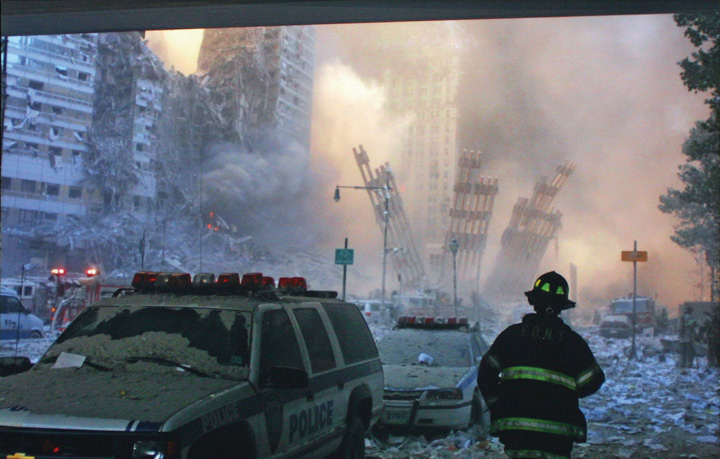 A firefighter standing in the remnants of the twin towers