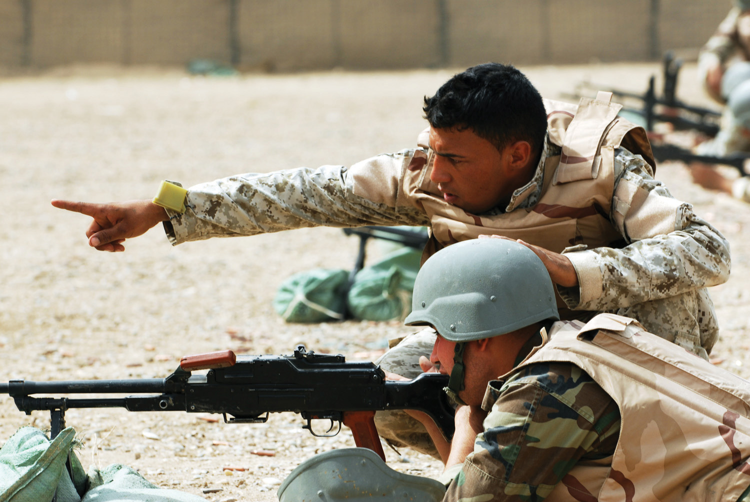 Men in the army working on target practice