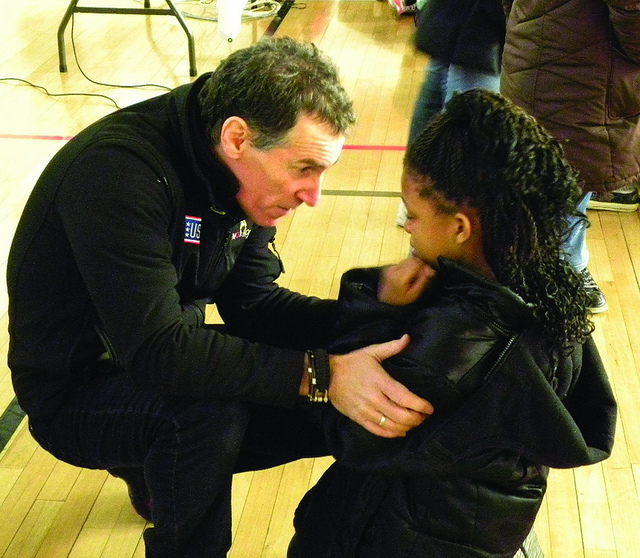 A police officer talking to a young girl