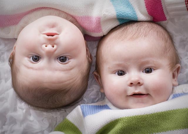 Twin babies side by side