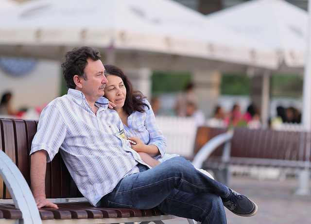 A couple sitting on a bench