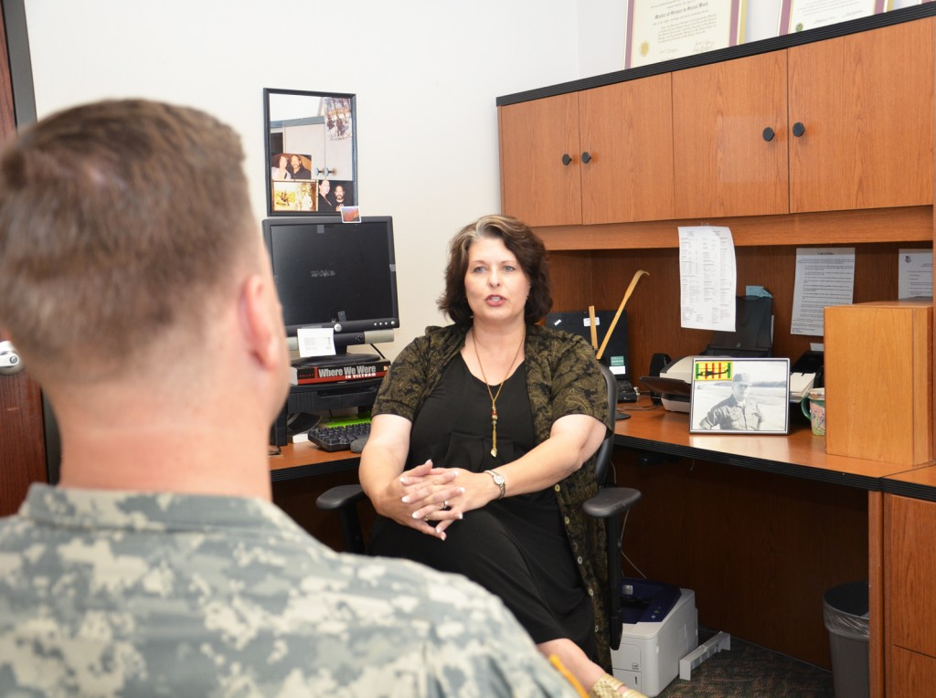 A woman social worker helping out a male veteran