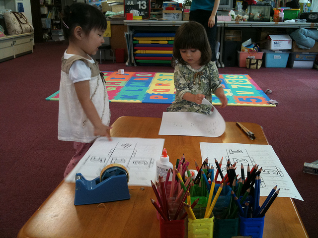 Pre schoolers working on arts and crafts