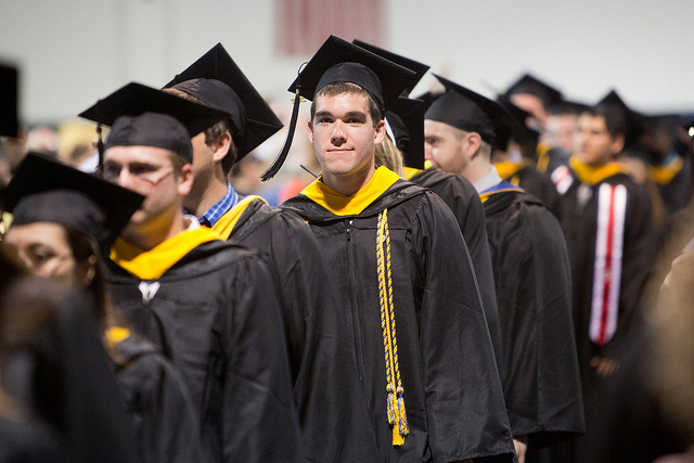 Students standing in line in their graduation gowns, ready for commencement 2012