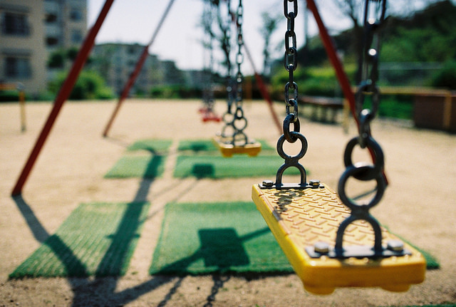 A swing set in a playgorund