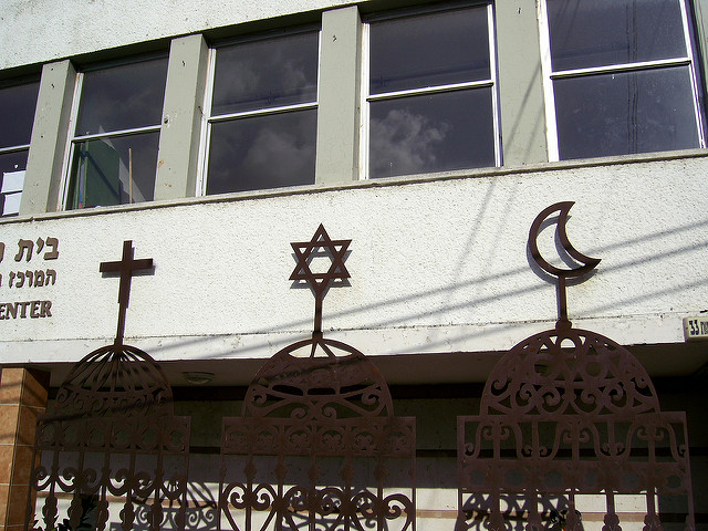 Three signs of religion, a cross, the star of David, and the crescent
