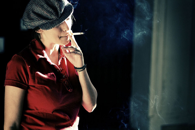 A woman smoking a cigarette