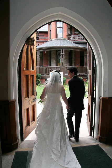 Husband and Wife exiting a church