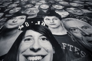 A printed sheet of people's faces