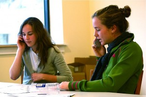 Two women performing phone interviews