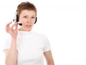 A telemarketer with a phone headset