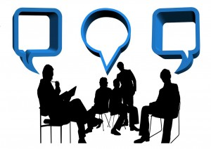 Exchange of ideas, many silhouettes of many different people with speech bubbles by each head