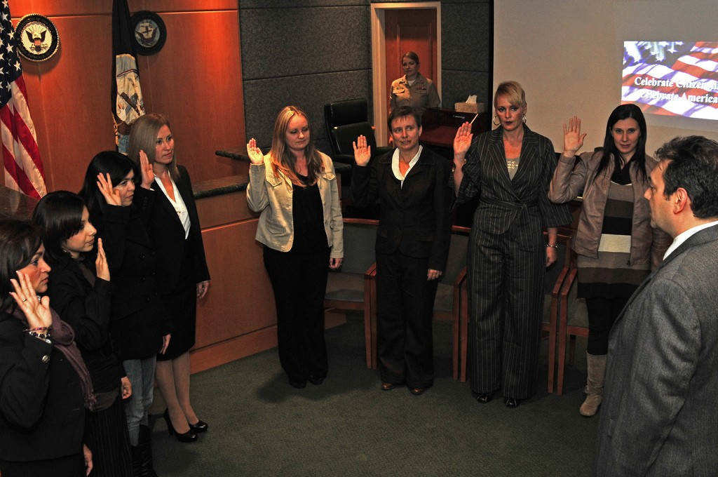 Spouses of United States service members in Italy take the oath of allegiance to become United States citizens