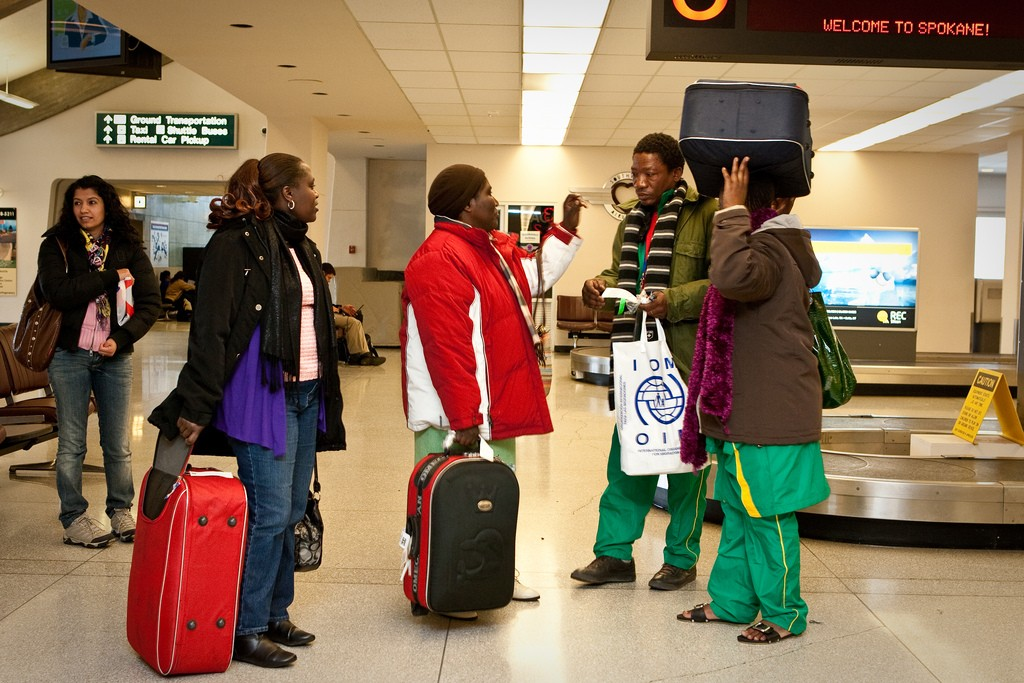 A Congolese family being met at the airport by their case worker