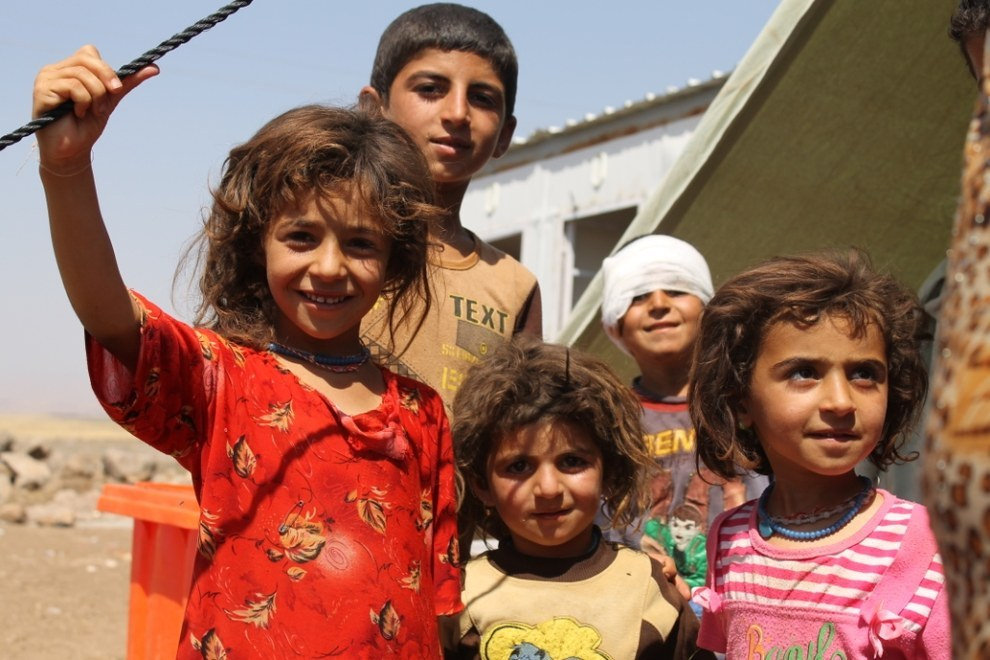 Iraqi refugee children preparing for relocation