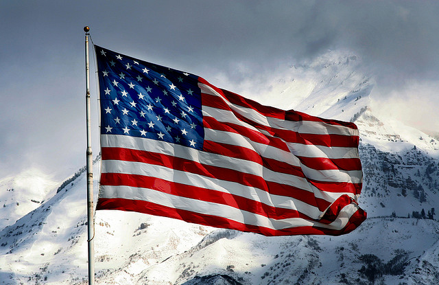 A US flag on a snowy mountain