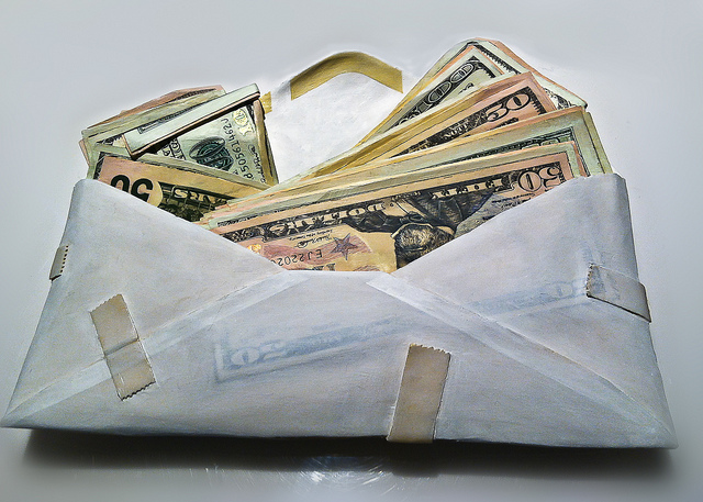 An envelope packed with cash money