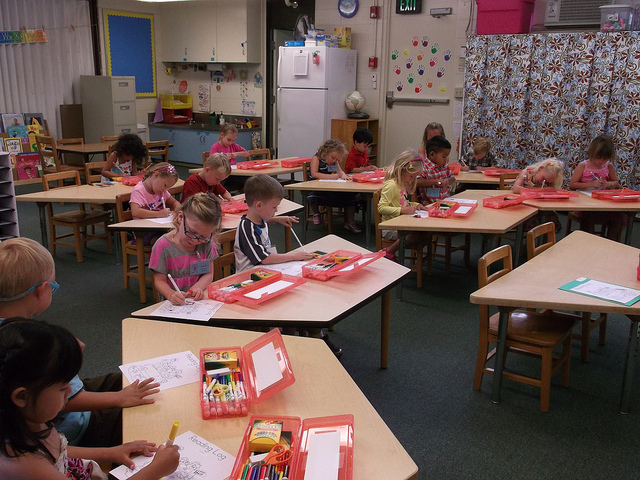 Kindergarteners doing arts and crafts
