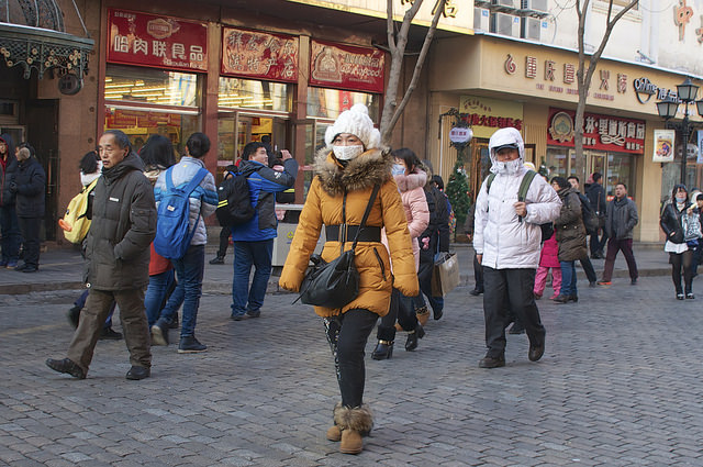A woman wearing a face mask to protect herself from sickness