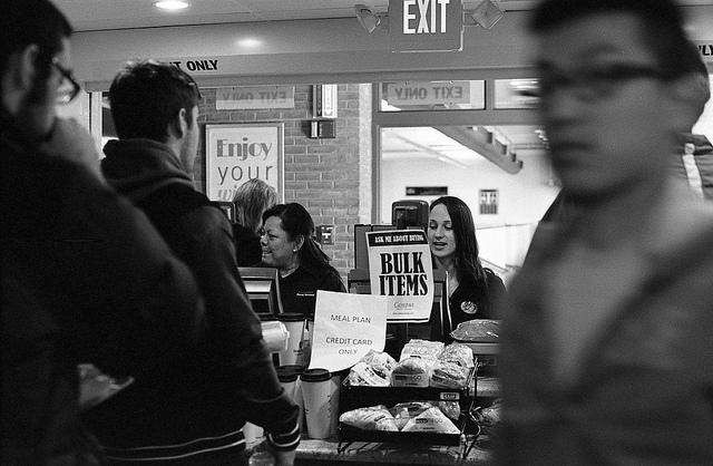 A cashier at a local bagel shop