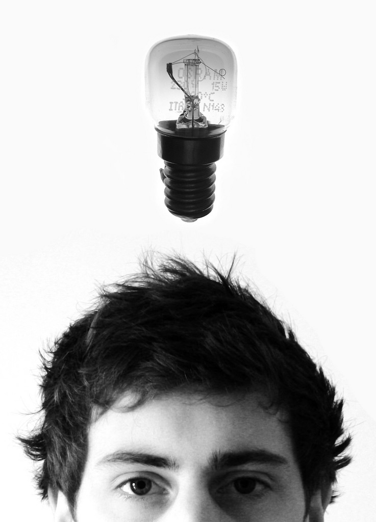A man with a lightbulb above his head