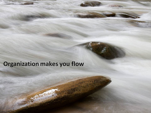 A motivational poster of water running over rocks. The caption says