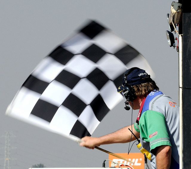 A man waving a checkered flag