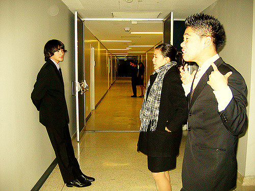Students practicing their speeches in the hallway