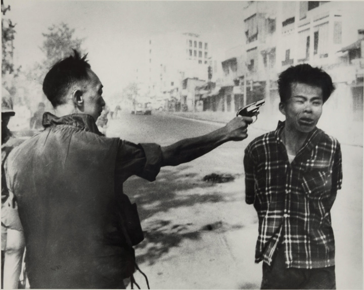 The director of South Vietnam's national police force executes a bound Viet Cong prisoner